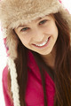 Portrait Of Teenage Girl In Snow Wearing Fur Hat - PhotoDune Item for Sale