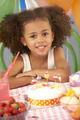 Young girl with birthday cake at party - PhotoDune Item for Sale