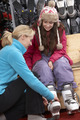 Sales Assistant Helping Teenage Girl To Try On Ski Boots In Hire Shop - PhotoDune Item for Sale