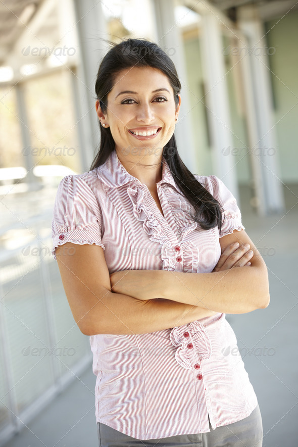 Teacher standing outside school building - Stock Photo - Images