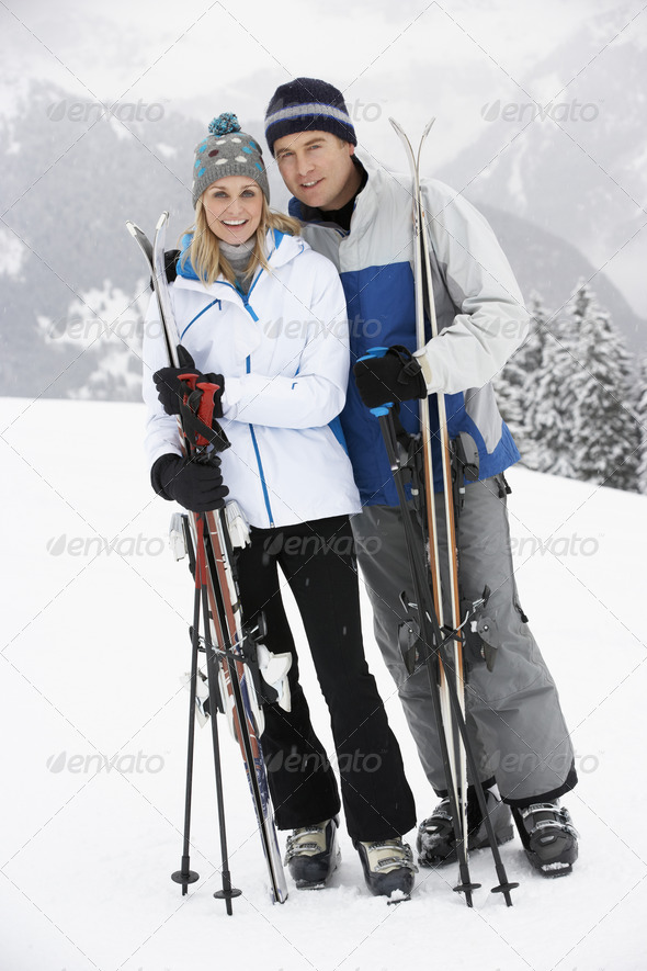 Middle Aged Couple On Ski Holiday In Mountains - Stock Photo - Images