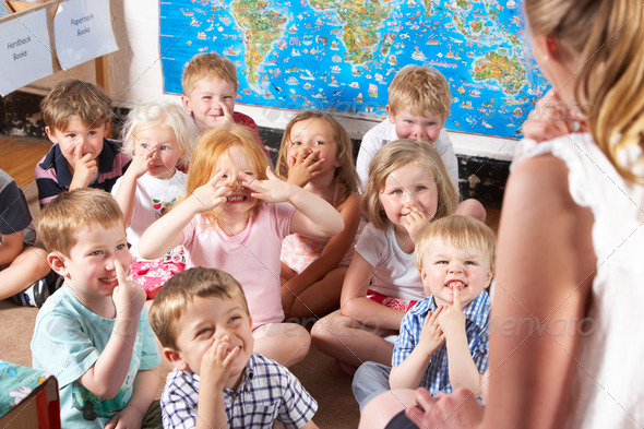 Stock Photo - PhotoDune Montessori Pre-School Class Listening to Teacher on Carpet 317226