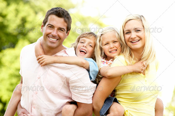 Family having fun in countryside - Stock Photo - Images
