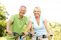 Mature couple riding bikes - PhotoDune Item for Sale