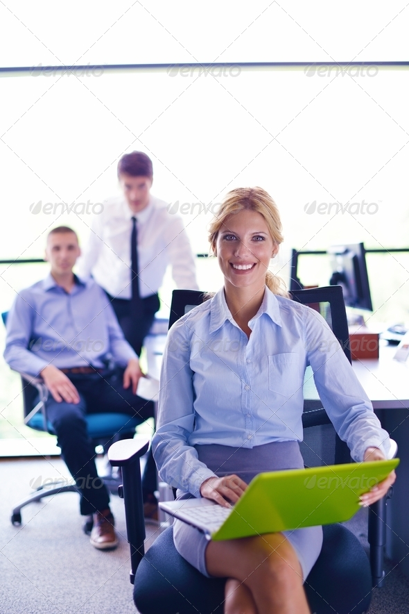 business woman with her staff in background at office - Stock Photo - Images