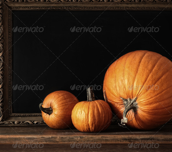 Different sized pumpkins on table - Stock Photo - Images