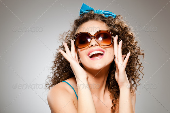 pretty girl with curly hair and perfect teeth - Stock Photo - Images