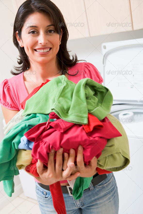 Woman Holding Pile Of Laundry - Stock Photo - Images