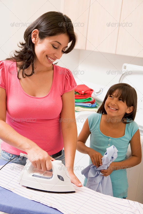 Mother And Daughter Ironing - Stock Photo - Images