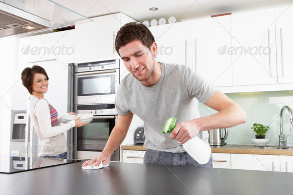 Stock Photo - PhotoDune Young Couple Cleaning Cleaning Modern Kitchen 324977