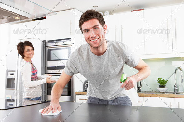 Stock Photo - PhotoDune Young Couple Cleaning Cleaning Modern Kitchen 324988