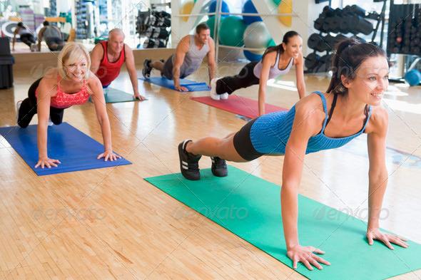 PhotoDune Instructor Taking Exercise Class At Gym 325393