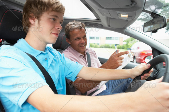Teenage Boy Taking A Driving Lesson - Stock Photo - Images