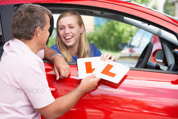 Teenage Girl Receiving Her Learner Plates - Stock Photo - Images