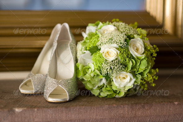 wedding shoes and flowers bouquet - Stock Photo - Images
