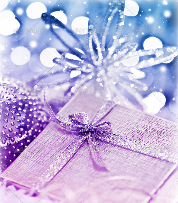 Purple blue Christmas gift with baubles decorations - Stock Photo - Images