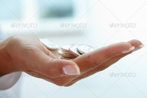 Coins in hand - Stock Photo - Images