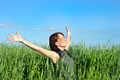 woman with hands raised up in the wheat field - PhotoDune Item for Sale