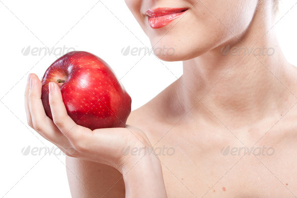 Portrait of smiling woman holding red apple isolated on white - Stock Photo - Images