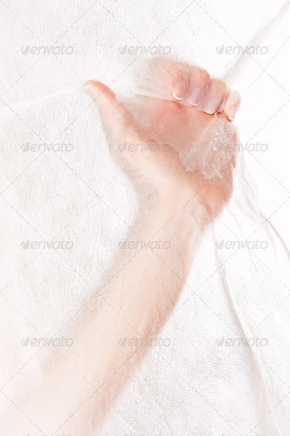 Beautiful female hand grabbing white fabric - Stock Photo - Images