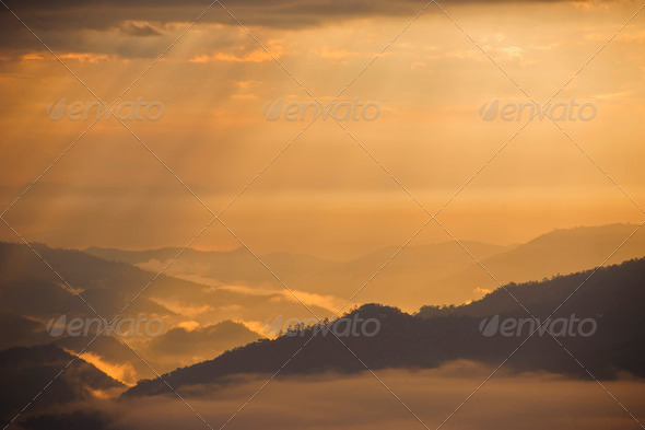 Sunset with mountain landscape, light - Stock Photo - Images