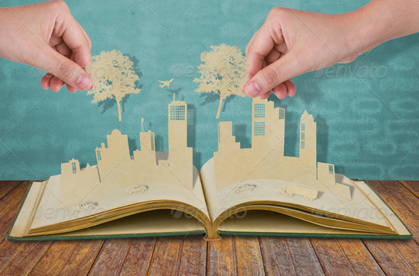 Hand hold paper cut  of tree over Paper cut of cities with car a - Stock Photo - Images