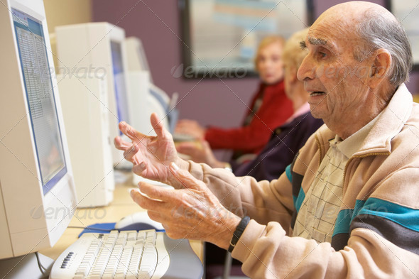 Senior man using computer - Stock Photo - Images