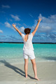 Happy woman standing on tropical beach. - PhotoDune Item for Sale