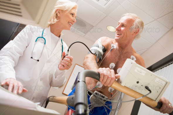Stock Photo - PhotoDune Doctor Monitoring The Heart-Rate Of Patient On A Treadmill 335035