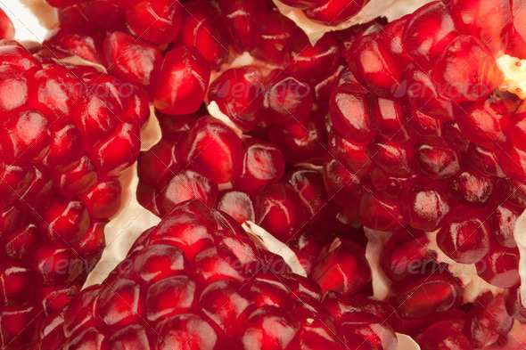 Red pomegranate fruit closeup detail background - Stock Photo - Images
