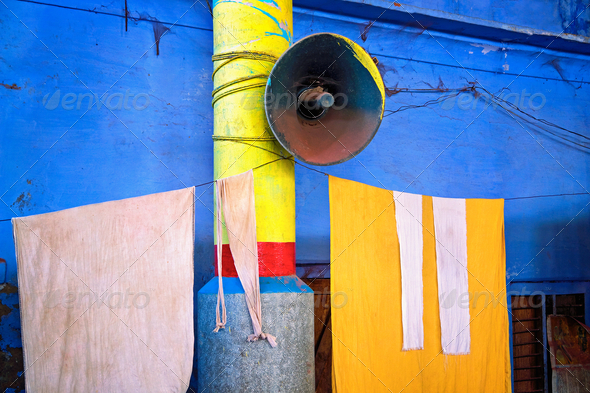 Blue wall with megaphone - Stock Photo - Images