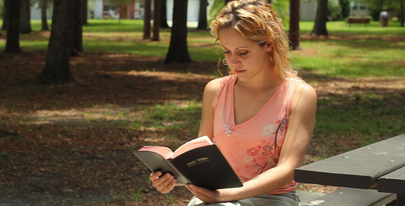 [VideoHive 337169] Woman Reads Bible Outside Dolly Shots | Stock Footage