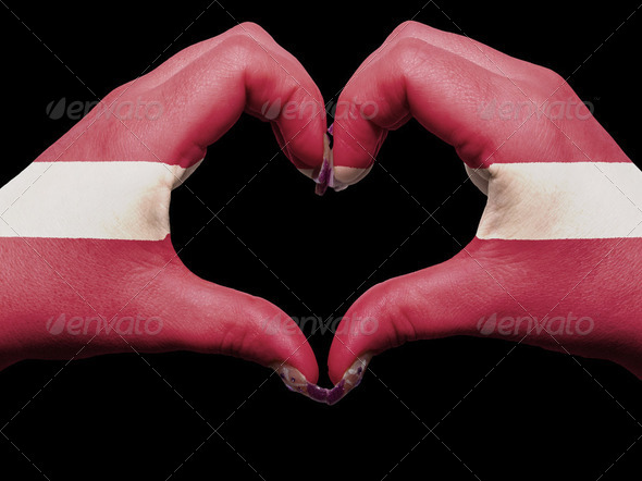 Heart and love gesture by hands colored in latvia flag for touri - Stock Photo - Images