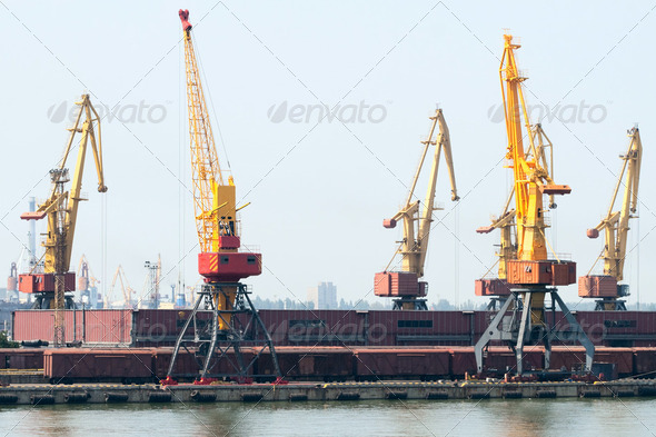 Trading port with cranes, containers and cargoes - Stock Photo - Images