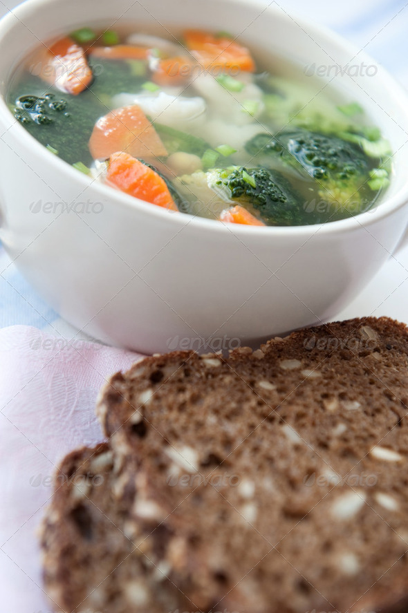 Healthy soup with wholemeal bread - Stock Photo - Images