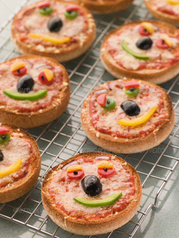 Stock Photo - PhotoDune Smiley Faced Pizza Muffins 337338