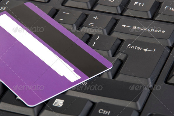 Credit card on keyboard - Stock Photo - Images