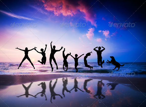 People and dog jumping on the beach. Happiness - Stock Photo - Images