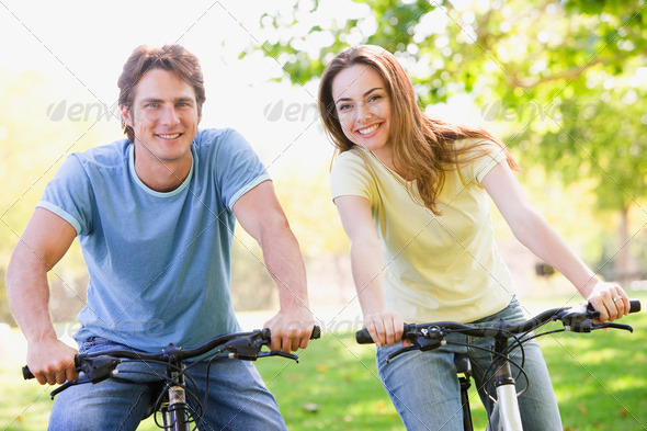 Stock Photo - PhotoDune Couple on bikes outdoors smiling 337635