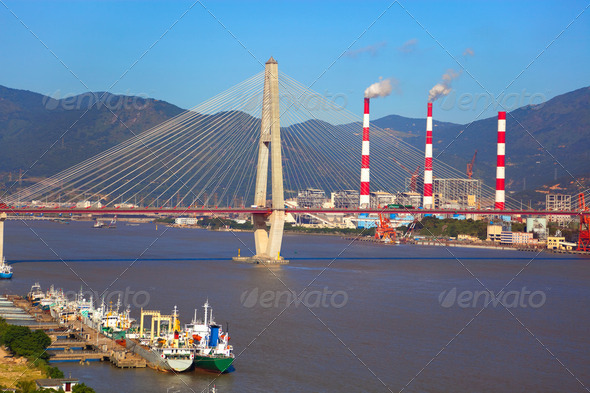 Cable-stayed bridge  and boatyard - Stock Photo - Images