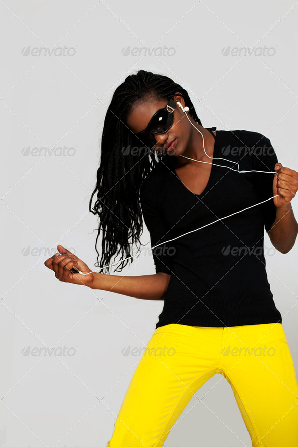Girl dancing to music - Stock Photo - Images