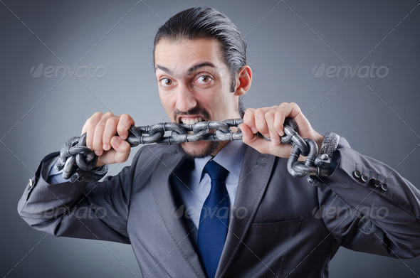 Arrested businessman in studio shooting - Stock Photo - Images