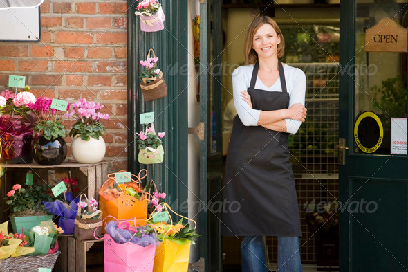 PhotoDune Woman working at flower shop smiling 339328