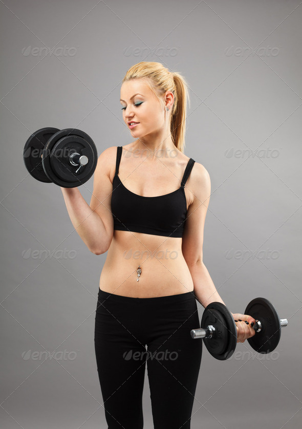 Athletic young lady working out with weights - Stock Photo - Images