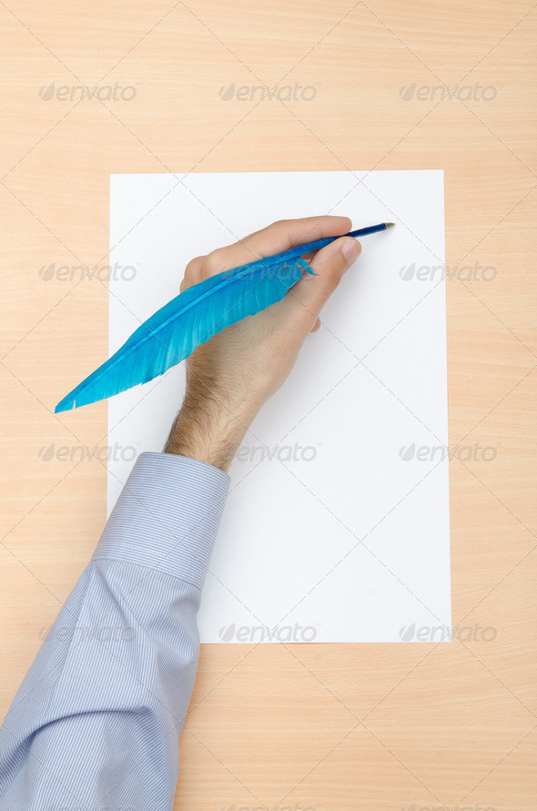 Hand writing with colourfil quill - Stock Photo - Images