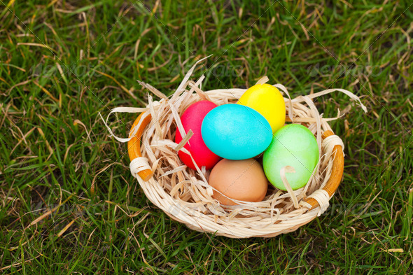 Basket with the colorful Easter eggs - Stock Photo - Images
