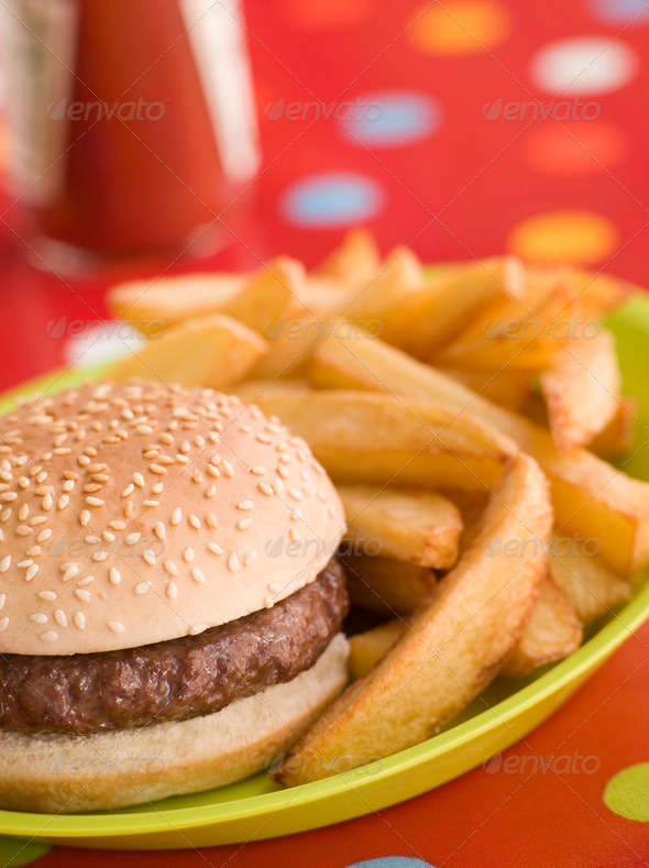Beefburger in a Sesame Seed Bun with Chunky Chips - Stock Photo - Images