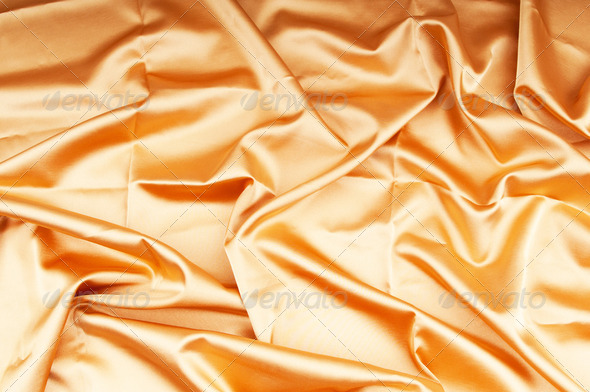 Bright satin fabric folded to be used as background - Stock Photo - Images