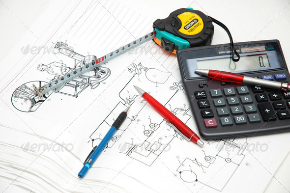 Design drawings, calculator, pens and measuring tape - Stock Photo - Images