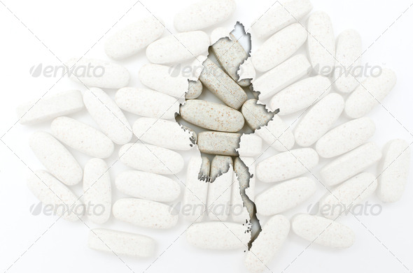 Outline map of myanmar with pills in the background for health a - Stock Photo - Images
